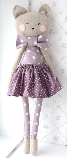 Piccola Lara. Her skirt is (gently) removable and she can be spot-cleaned. Her arms are jointed with little wooden heart-shaped buttons and she can stretch them up and down or side to side. She can be balanced to stand or sit. Due to small parts she is not suitable for unsupervised