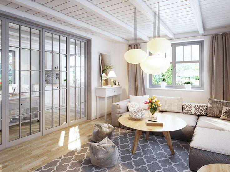 Efektowne szklane drzwi oddzielające przestrzeń salonu od kuchni