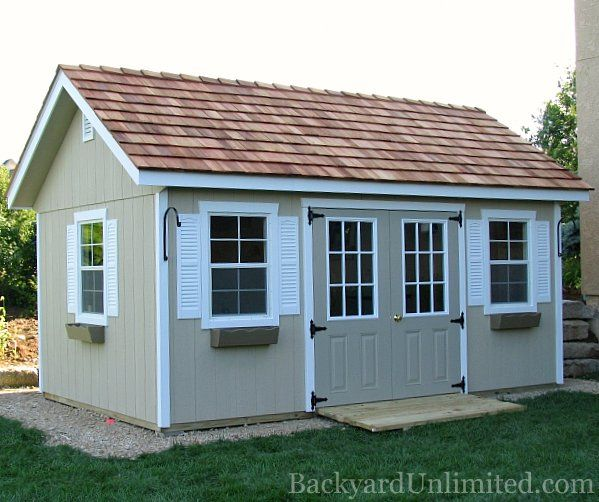 10'x16' Garden Shed with 9-Lite Painted Fiberglass Doors, Vinyl Shutters, Flower Boxes, Gable Vent, Ramp, Window Trim, Additional Window, and Cedar Shake Roof http://www.backyardunlimited.com/sheds/garden-sheds