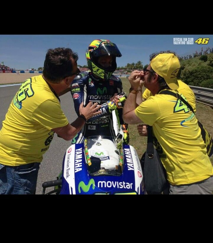 Valentino Rossi celebrating with his fan club after finishing 2nd at Jerez 2014