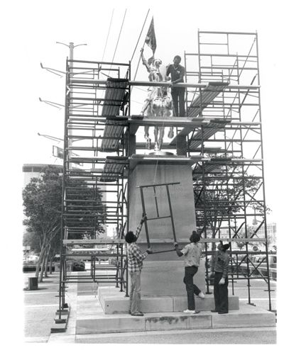 Workers resettle Joan of Arc on her pedestal in 1984.  The statue was regilded in 1984 by two French government workers, Claude Ducroizet and Jean Maillard, brought to New Orleans specifically for this task. The French city of Orleans helped Mayor Dutch Morial's administration pay for the work, and Orleans Mayor Jacques Douffiagues came to New Orleans to rededicate the statue on May 11, 1984, attending the opening of the Louisiana World Fair the following day.  The statue was repaired and…