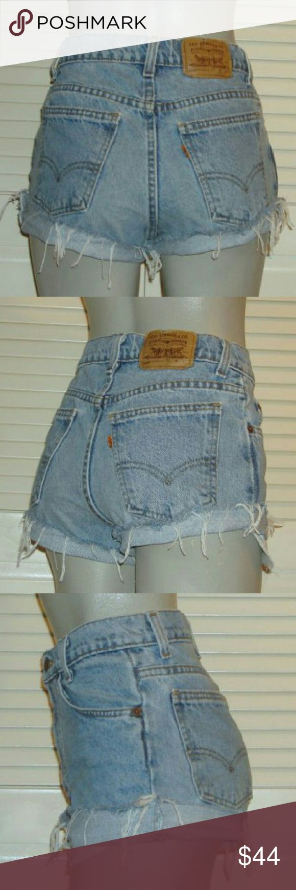 """Vintage Levis 550 Orange Tab High Waist Cut Offs This pair of Vintage Levi's 550 cut off blue jean shorts are 26"""" around the waist, 32"""" around the hips and have a 9 3/4"""" rise. Levi's Shorts Jean Shorts"""