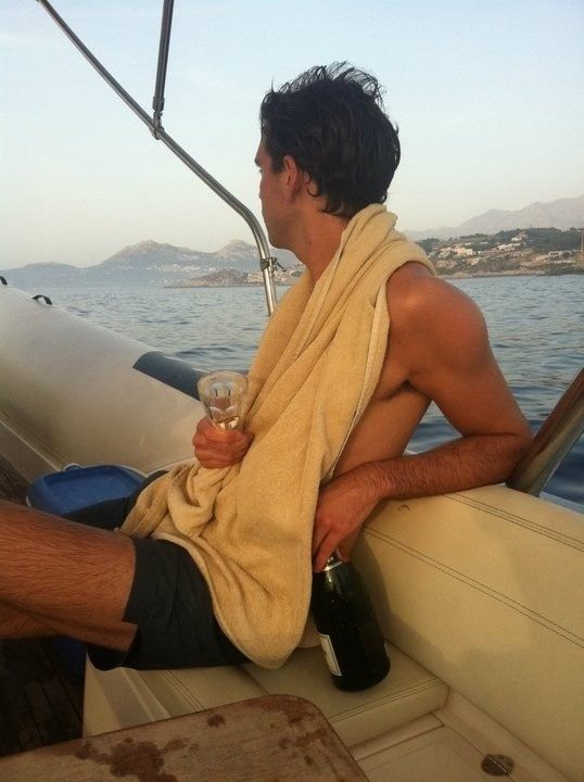 """Mika relaxing on a boat with wine 2011 - from the """"Mika Backstage"""" album on Mika's Facebook page"""