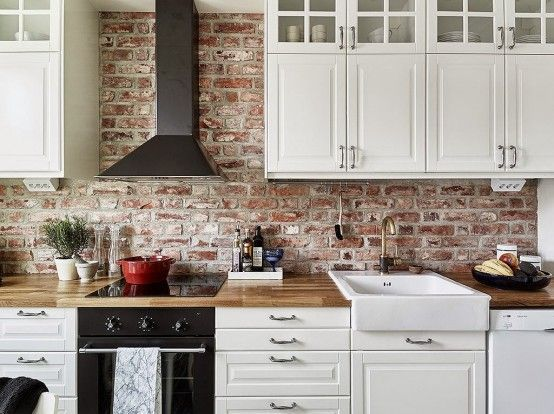Inviting And Cozy White Kitchen With Brick Backsplash Exposed