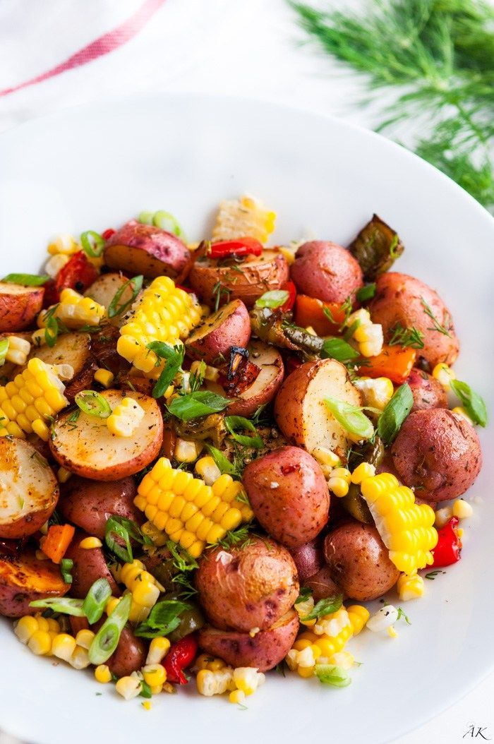 Southwest Roasted Potato Salad - One pan roasted red potato salad with bell pepper, corn, fresh dill and spices drizzled with olive oil.