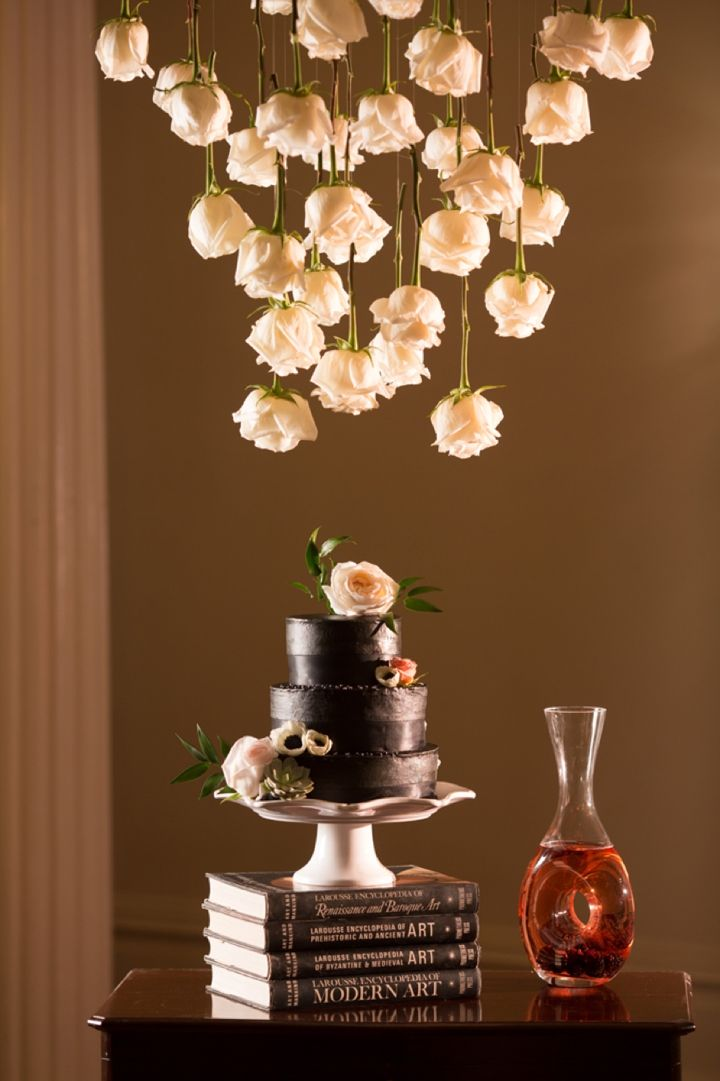 LOVE the flowers hanging above the cake, so creative!! -Bold Dramatic Blush and Black Wedding Ideas