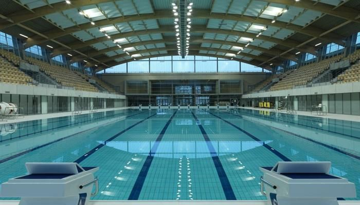 floating arena the olympic swimming pool in szczecin poland made of profiled glass pilkington