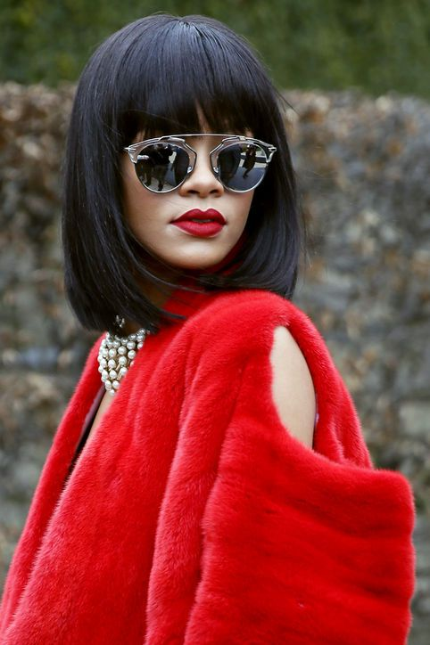 Rihanna in round aviator style sunglasses, red lipstick & red fur #style #fashion #celebrity