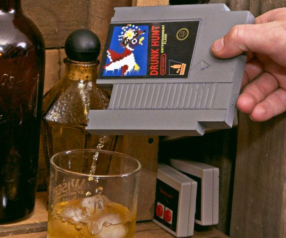 "Get nostalgic with your alcoholic adventures with the NES cartridge flask. This geeky yet discrete drinking flask is designed to resemble a retro NES cartridge and is available with five different parody video game labels such as ""Drunk Hunt"" and ""The Legend of Drink""."
