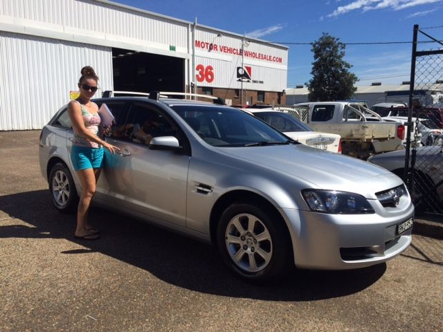 A great client picking up her new VE Sportwagon! Thanks for visiting Motor Vehicle Wholesale.