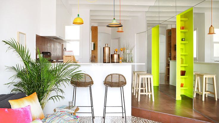 Miel Arquitectos has added bright pops of colour to a Barcelona apartment that is tailored towards tourists.