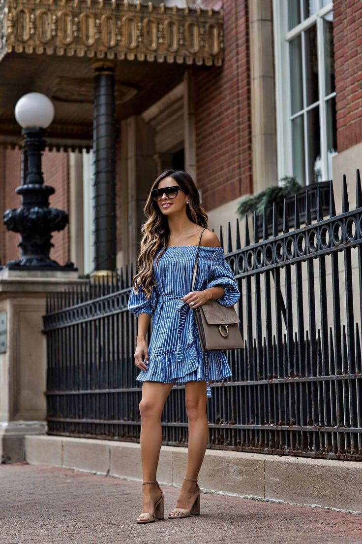 fashion blogger mia mia mine wearing a lovers + friends dress and celine sunglasses