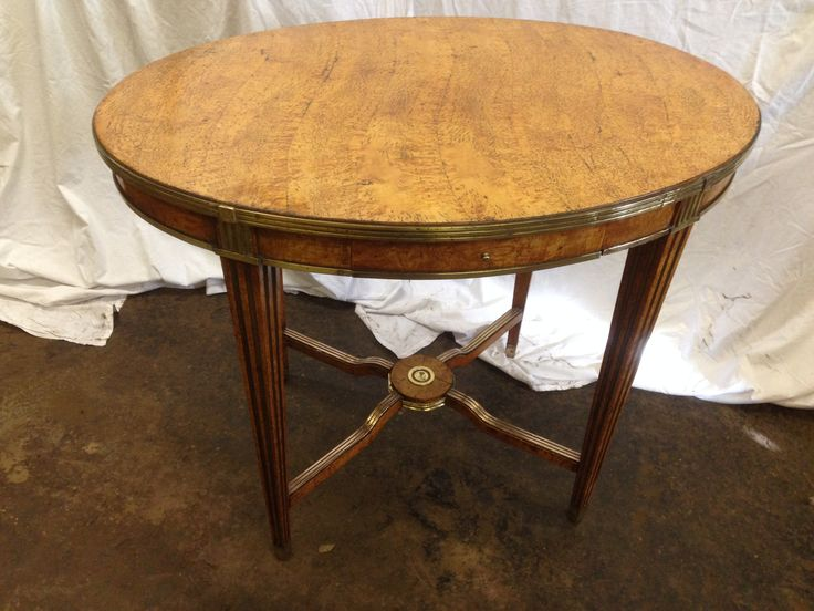 Antique early oval 19th century French pollard maple occasional table with brass inlay