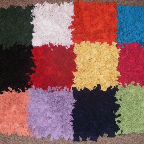 ELMER Rag Rug ♥ £30     Made from recycled t-shirts in bright coloured squares   to match the elephant who says it is OK to be different!   Ideal for a preschool reading corner,   primary school classroom, child's bedroom or playroom.   Measures approx 50 x 70cm. Washable.     Made to order, please allow 28 days for collection of materials and making. Note - designs and colours vary according to the availability of t shirts at car boot sales!