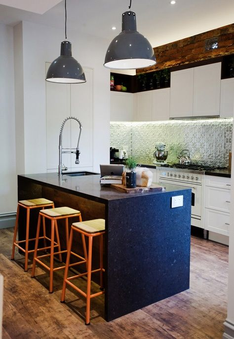 Funky lamps add quirkiness to a kitchen. Also like backsplash tin