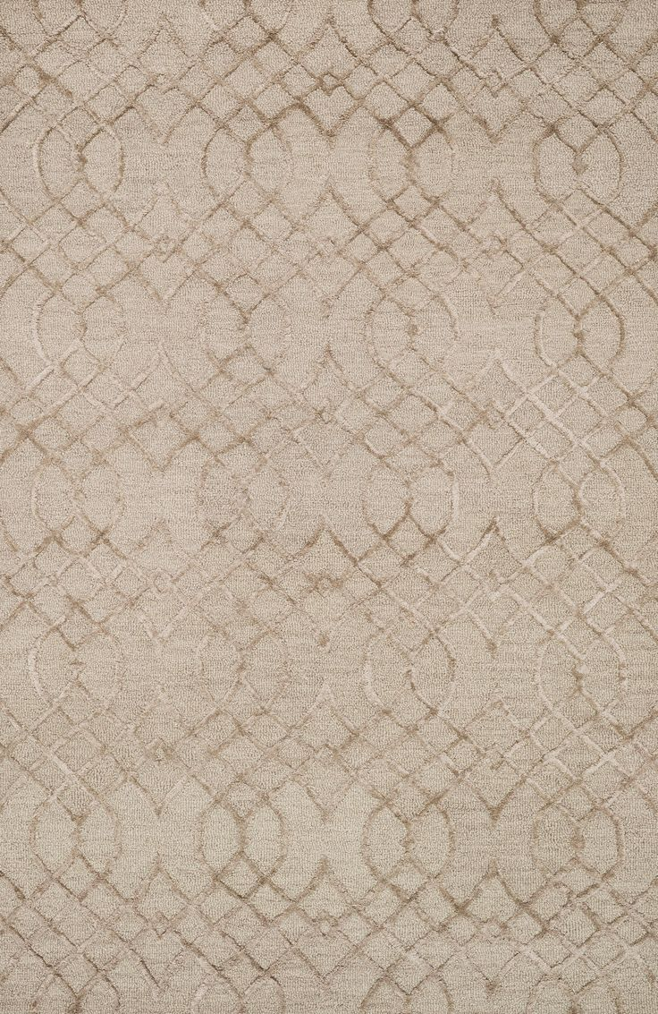 Distinguished by its textural effects and mix of fibers, the Panache Collection looks and feels like no other geometric patterned rug. The base of each Panache is hooked with wool for natural comfort,