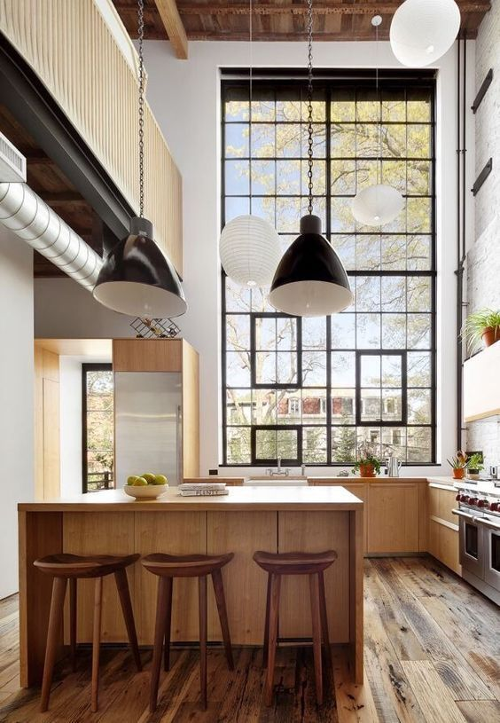 Cosy wooden kitchen with big assymetric window and black &  white lighting.