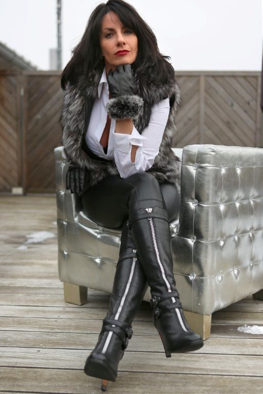 Sexy woman in leather boots, pants, white blouse, gray and white ...