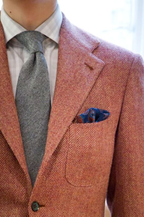 Red and White herringbone tweed jacket paired with light Grey tie