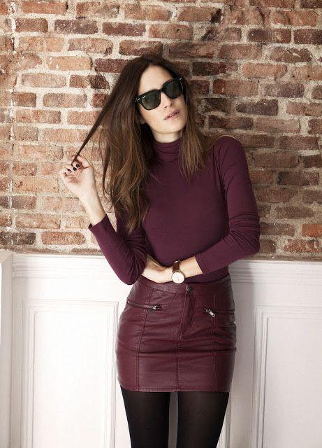 Carole Radziwill:  Leather miniskirt, black opaque hose.