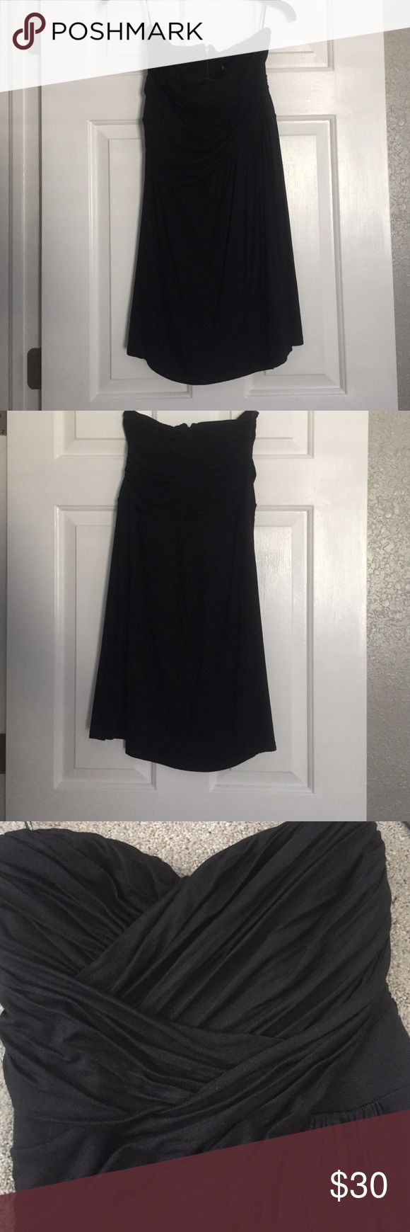 Express black tube top dress Express black tube top dress with rouching detail on top. Back zipper with hook closure. Worn once Express Dresses Mini
