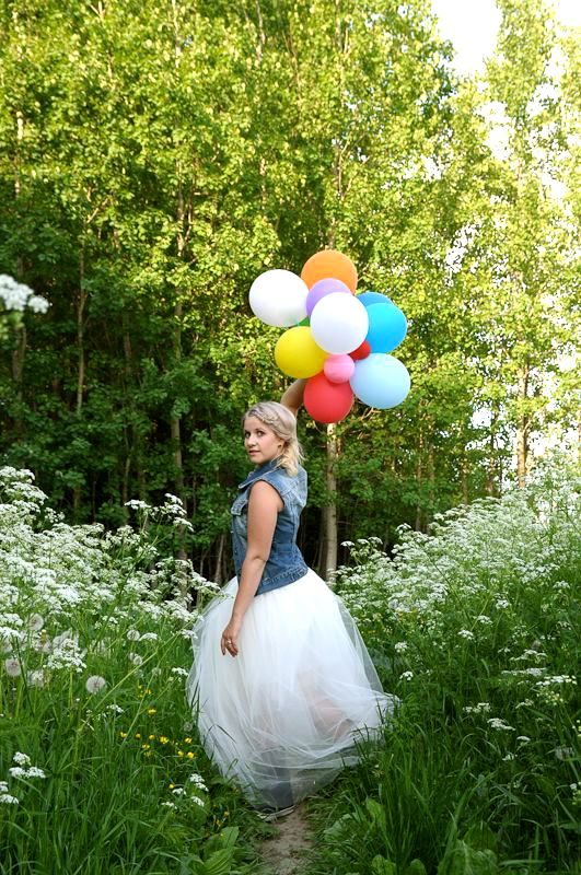 Girl with balloons and tulle skirt