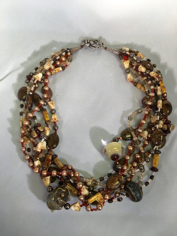 multi strand necklace uses one of a kind lamp work beads with stone and pearl accents toggle clasp length 19 inch