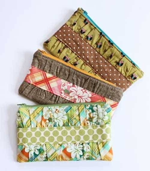 Turn this zippered pouch into a cute clutch by using your favorite coordinating fabrics to make gathered texture on the front. Add a divider and some small