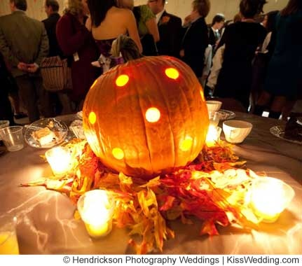 pumpkin with poked holes gives affordable nighttime ambiance via 15 simple fall wedding ideas