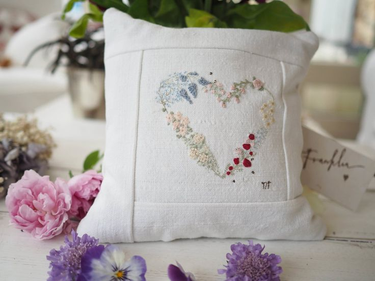 embroidered lavender cushion with heart garland of flowers