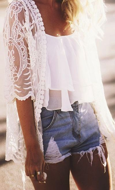 Sheer kimono top, crop top, and Jean shorts.