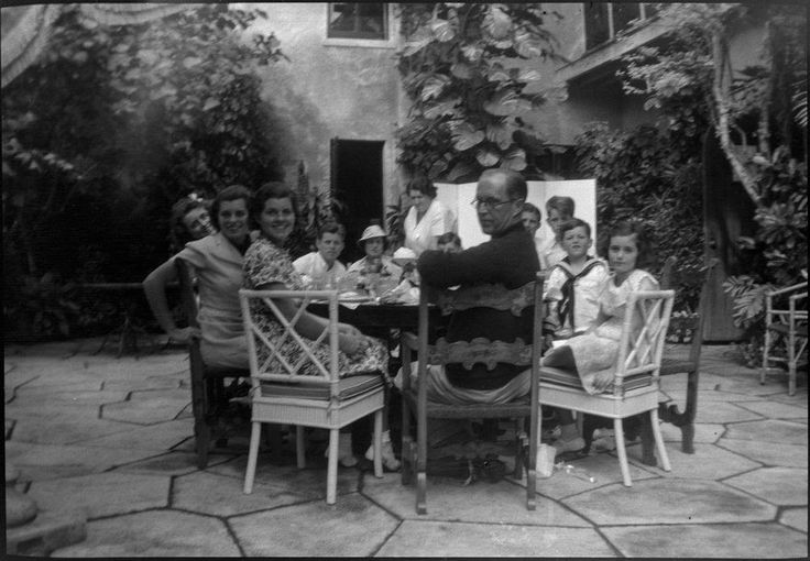 The Kennedy family may have paused a spirited discussion to take this photo over dinner at Palm Beach, FL. Jack leans into the photo from the rear of the table, seated next to his mother. Photo Credit: JFK Library, KFC1156N