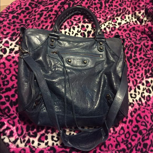 Balenciaga velo Used. Leather. Balenciaga velo blue . Comes with dustbag and strap. One tassel missing on zipper. PRICE REFLECTS AUTHENTICITY. Balenciaga Bags