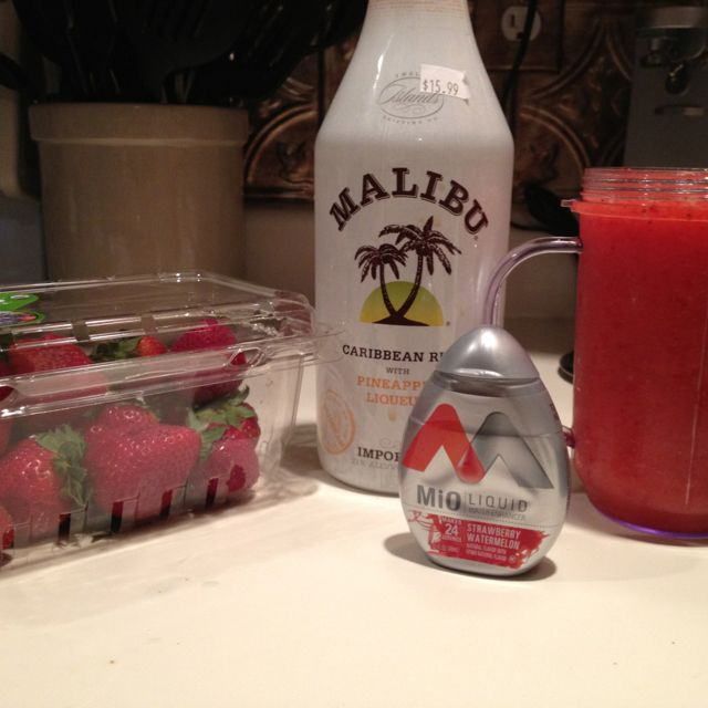 Drink 2 of the night: crushed ice, water, 5 strawberries, pineapple rum, and strawberry watermelon MiO.... Another low cal alcoholic beverage