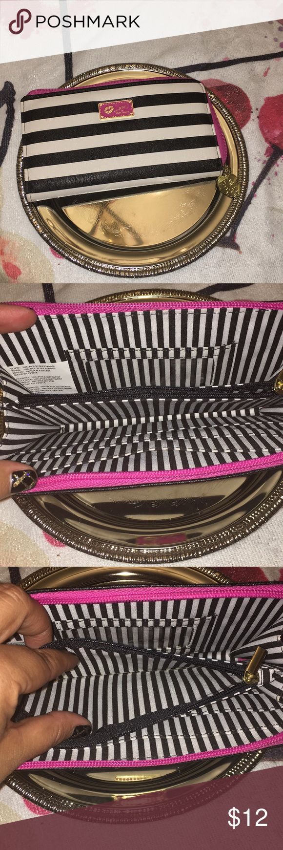 Betsey Johnson Zipper Wallet Fun and funky, black and white striped wallet with pink zipper and Betsey Johnson logo. Credit card slots, ID slot and inside zipper for coins. Perfect for any Betsey Johnson lover!   Thanks for looking! Let me know if you have any questions. Happy Shopping! 🛍 Betsey Johnson Accessories Key & Card Holders