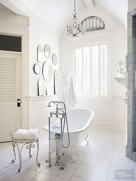 The English relied on shutters to control sunlight and shield interiors from an unexpected burst of rain or snow. Shutters are still a distinguished dressing for windows, especially in rooms where privacy is key and where curtains might be heavy-handed. Other old-world touches in this cottage bathroom include marble flooring and an assortment of frameless mirrors./