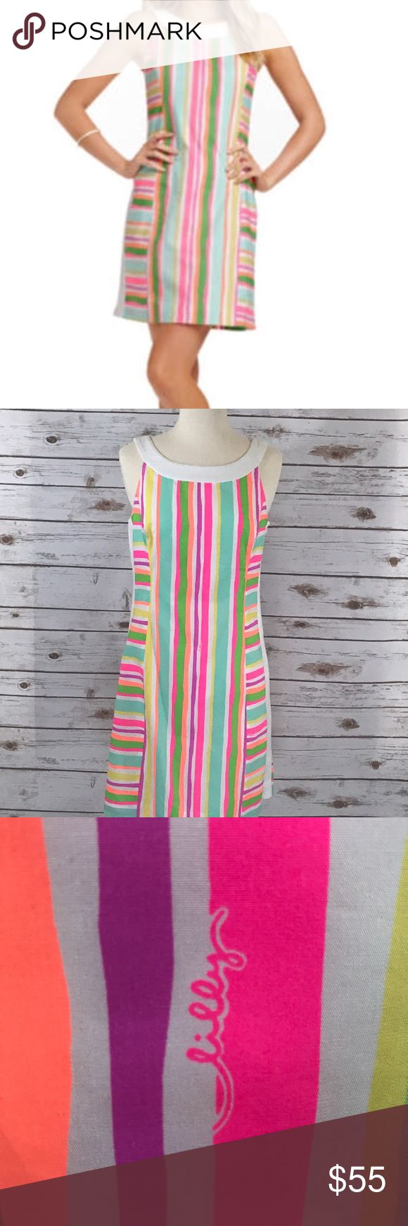 Lilly Pulitzer Darcy sheath This adorable Lilly Pulitzer Darcy is perfect for Spring/Summer. It features a neon stripe, waffle weave side stripe, zip up the side, bow back and fully lined. 100% cotton and in perfect condition Lilly Pulitzer Dresses