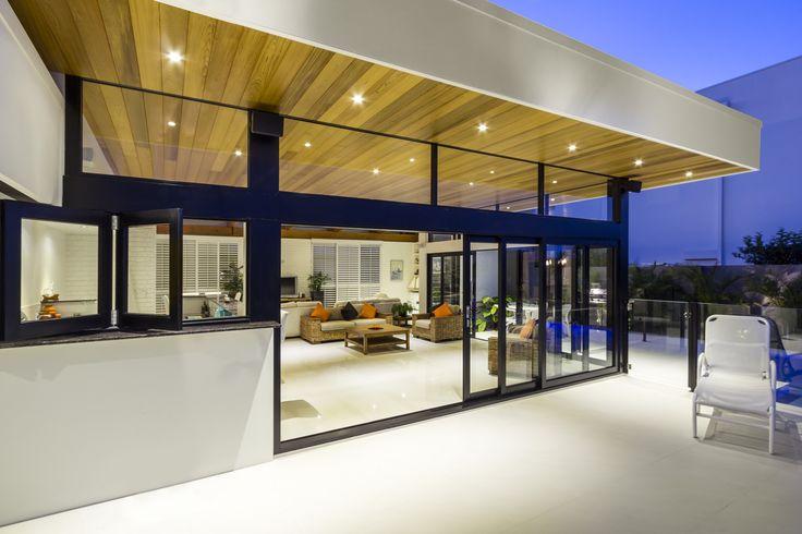 Striking black aluminium windows and doors by A&L.