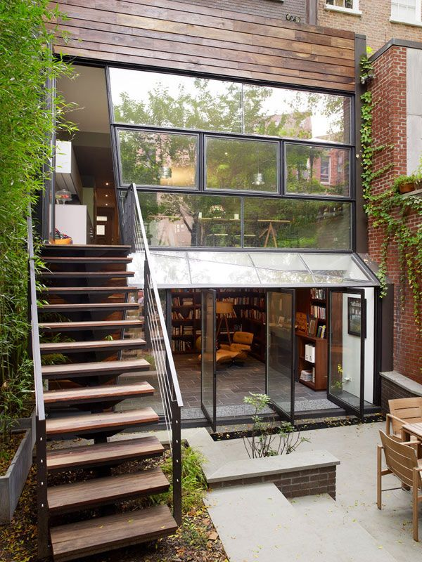 <3 3,400 sq. ft., (3) Three story, split-level, brownstone landmark townhome in prestigous, Chelsea, New York. My favorite qualities of this design are the cascading greenery, the courtyard, woodwork and brick, and the terrace off the master bedroom accessed by pivoting doors...amazing!