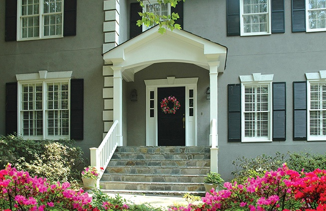 Portico With Wide Stairs For Stucco Home Designed By