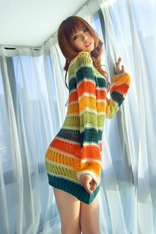 Awesome girl. And sweater.