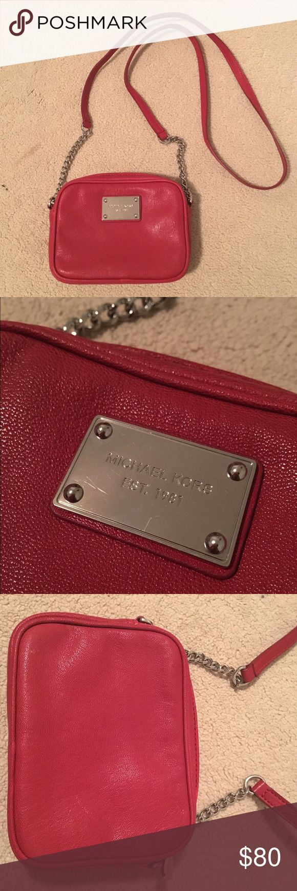 "MICHAEL KORS Jet Set Crossbody Bag ❤️ Authentic Michael Kors Jet Set crossbody bag in red leather and silver hardware and chain. Worn only twice and in excellent like new condition! Interior pouch pocket, 3 card slots, and full zipper. Approx 7""L x 5""H x 1.5""W. This is the perfect small purse for holding daily essentials like cell phone, card/cash, lipstick & more! It can also be worn as a clutch when shoulder strap is tucked in! Michael Kors Bags Crossbody Bags"