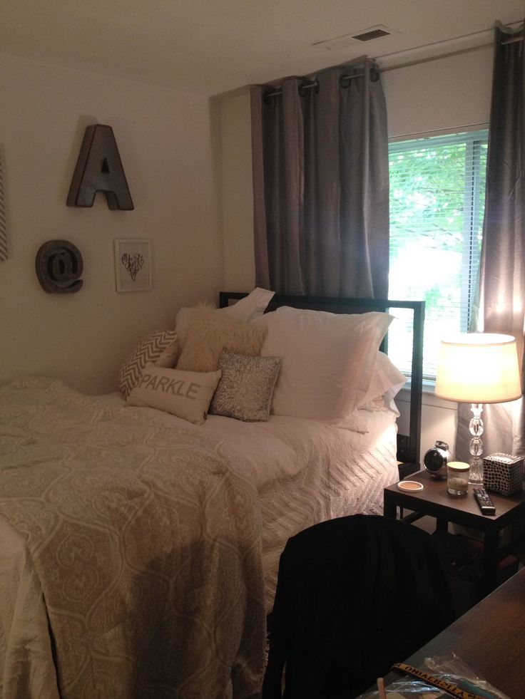"More college apartment decor ideas. Making the most of what you have. Re-purposed dorm gear plus things from home to complete your ""home away from home."" (Curtains from Burlington Coat Factory. Cost for TWO gray, faux silk, grommet top panels for $24.99. Silver sequined accent pillow for $7.99.)"