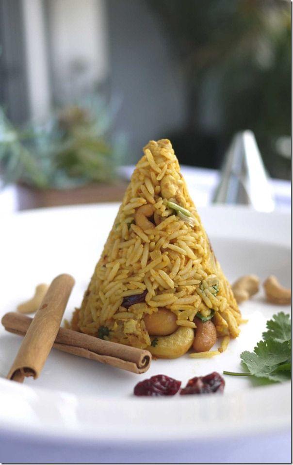 Indian biryani rice with cashew and raisins.