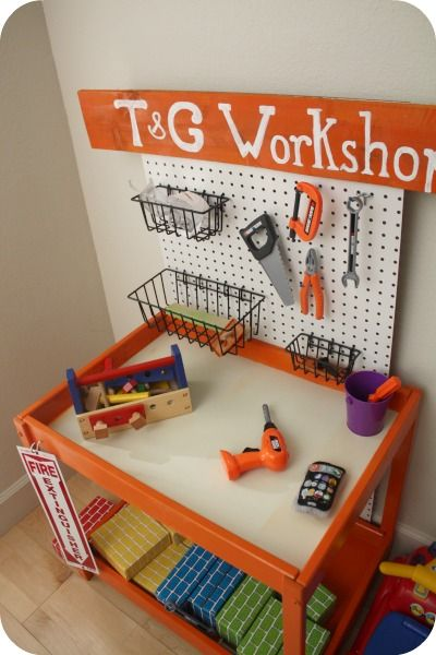 Ikea table turned workbench! @Rachel Hix Lane =here is what you can do with your changing table!!