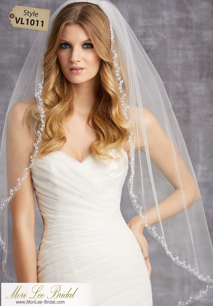 Style VL1011Veil Edged with Floral Designs of Sequins, Bugle Beads, and RhinestonesAvailable in Fingertip Length (VL1011F) Shown, or Cathedral Length (VL1011C). Colors: White, Ivory, Gold.