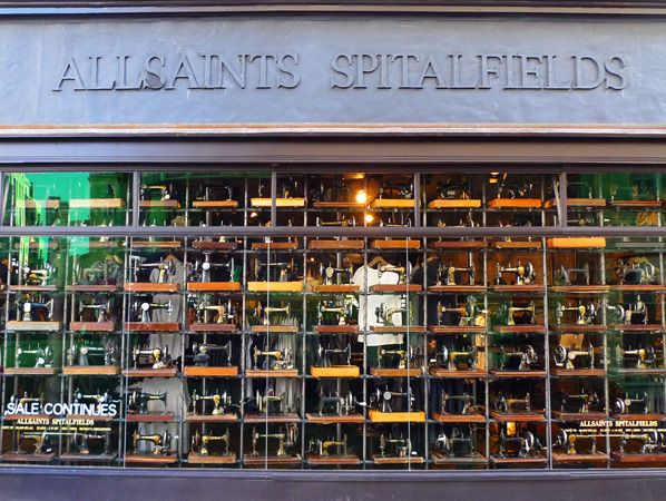 Vintage sewing machines in the window of the Allsaints Spitalfields store in London, England