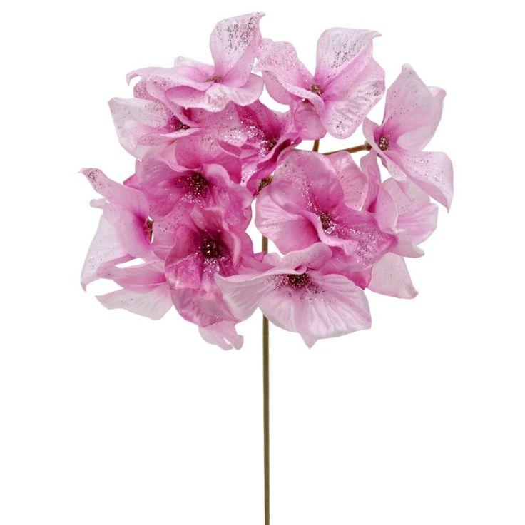 Umelý kvet s trblietkami na lupeňoch.