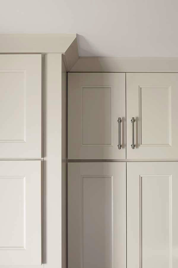 Crown moulding, like this Shaker Crown Moulding, adds the perfect finishing touch to the tops of wall and tall cabinets.