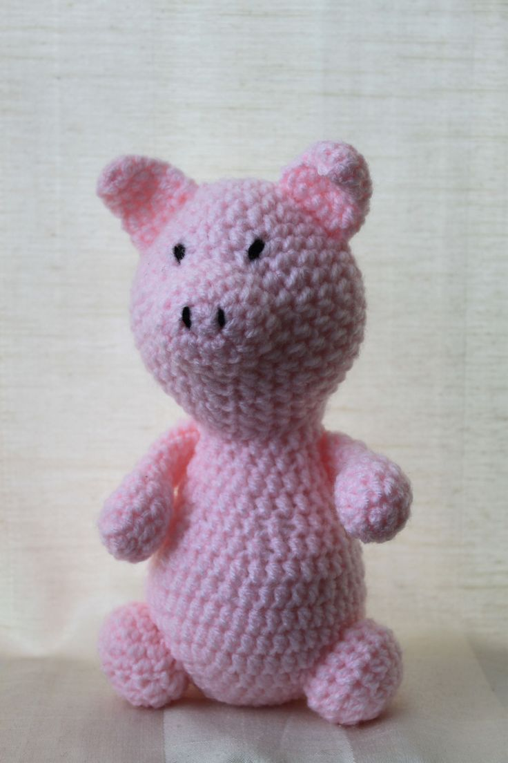 Peggy the pig. Amigurumi plush animal. The animal is approximately 20 cm tall.